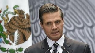 Enrique Pena Nieto delivers a speech at the National Palace in Mexico City, October 6, 2014.