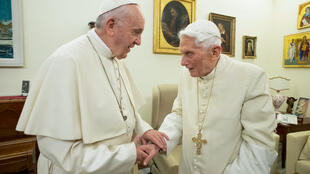 Benedict (R) has been accused of attempting to undermine the modernisation drive of his successor Pope Francis (L)