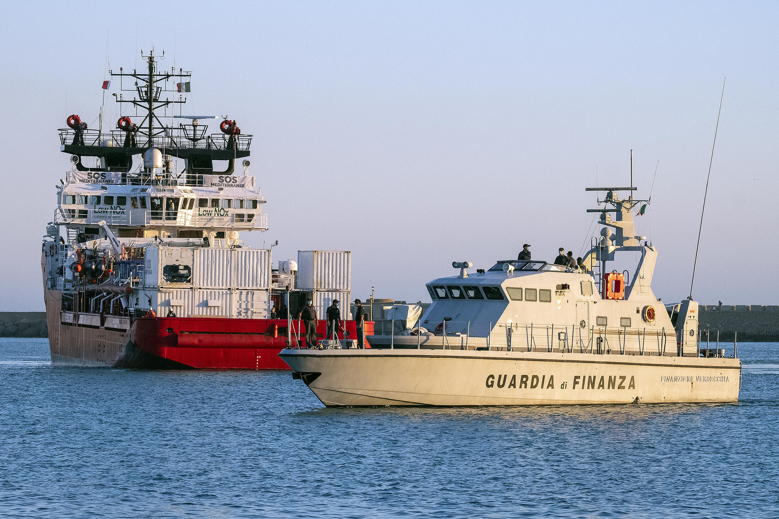 Migrants on board the humanitarian aid boat Ocean Viking, chartered by charity group SOS Mediterranee, arrive on July 6, 2020 in the harbour of Porto Empedocle on the island of Sicily.