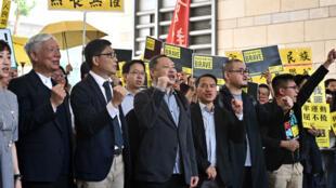 """Plusieurs figures du """"mouvement des parapluies"""", mardi à Hong Kong. Parmi eux, Tanya Chan, fondatrice du Parti civil, le pasteur baptiste Chu Yiu-ming, le professeur de sociologie Chan Kin-man et le professeur de droit Benny Tai."""