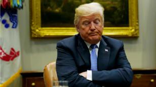 El presidente de EE. UU., Donald Trump, reacciona mientras realiza una mesa redonda sobre la Ley de Modernización de la Revisión del Riesgo de Inversión Extranjera en la Casa Blanca en Washington, EE. UU., el 23 de agosto de 2018.