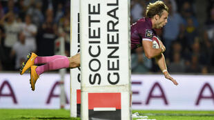 Up in the air: scrumhalf Yann Lesgourgues scores a try for Bordeaux Begles, who may lead the suspended Top 14 but might not land the title