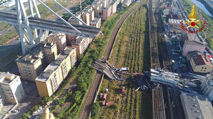 Dozens of cars and several trucks crashed onto railway tracks when the Morandi motorway bridge collapsed in August 2018 killing 43 people