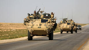Des troupes américaines patrouillent dans le nord de la Syrie, près du village d'Ain Issa, le 3 juin 2017.