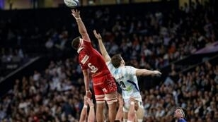 At a stretch: Scarlets flanker Ed Kennedy jumps for the ball with Racing92 flanker Fabien Sanconnie