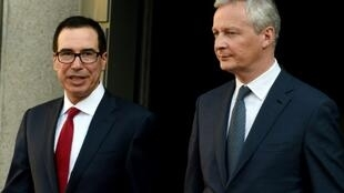 US Treasury Secretary Steven Mnuchin, left, met with French Finance Minister Bruno Le Maire in Paris on Wednesday