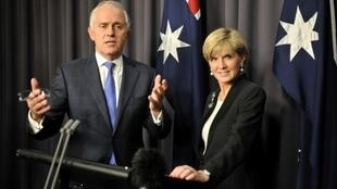 Newly elected Australian Prime Minister Malcolm Turnbull (L) speaks at a press conference with deputy leader Julie Bishop (R) after ousting Tony Abbott in a leadership ballot in Canberra on September 14, 2015.