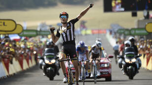 Great Britain's Stephen Cummings celebrates as he crosses the finish line at the end of the 178.5km 14th stage of the 102nd edition of the Tour de France on July 18.