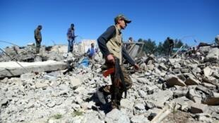 مقاتلون من وحدات حماية الشعب الكردي في المالكية في 25 نيسان/أبريل 2017