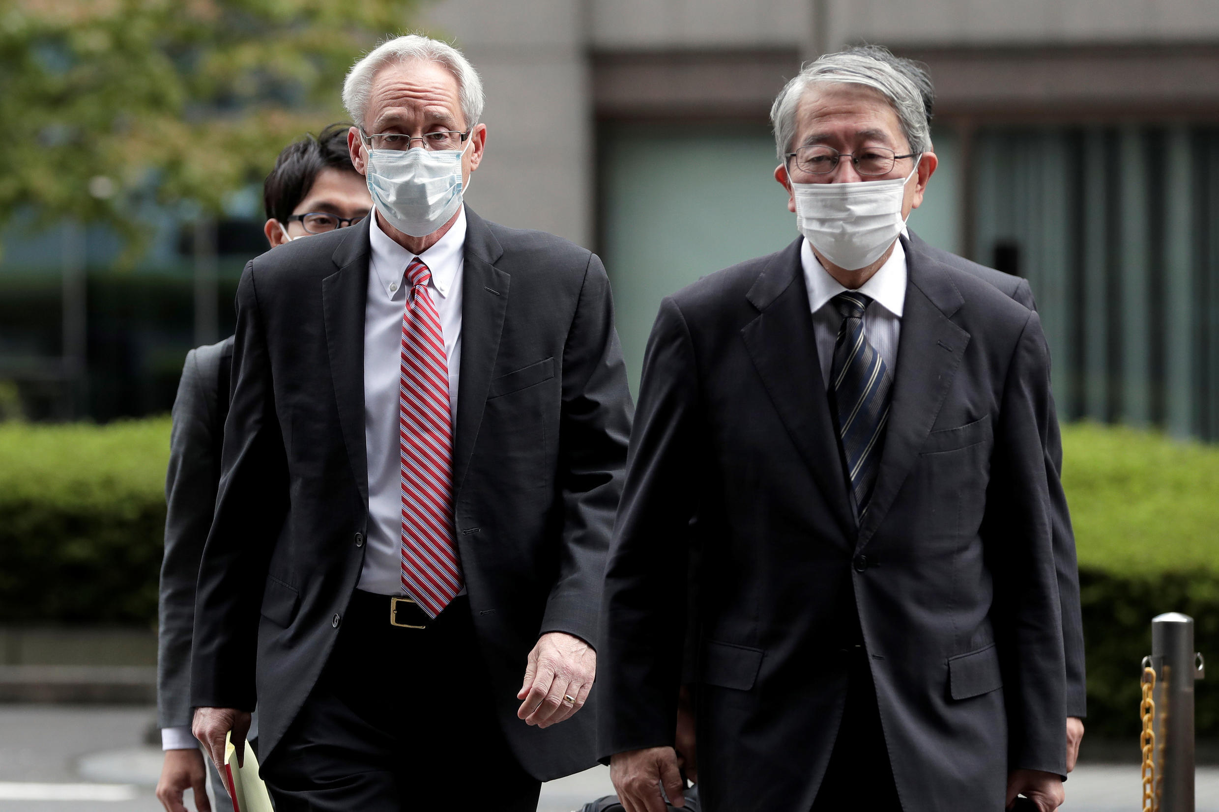 Greg Kelly (L), former representative director of Nissan Motor Co., arrives for the first trial hearing at the Tokyo District Court in Tokyo, Japan, September 15, 2020. Greg Kelly (L), former representative director of Nissan Motor Co., arrives for the first trial hearing at the Tokyo District Court in Tokyo, Japan, September 15, 2020.