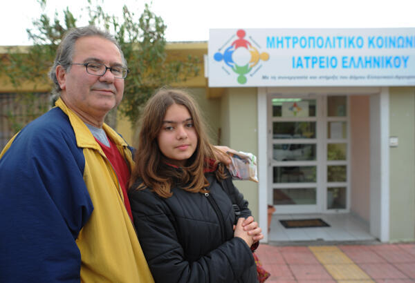Spiros, 55, and daughter Ella, come to the Helleniko clinic for his heart medication.