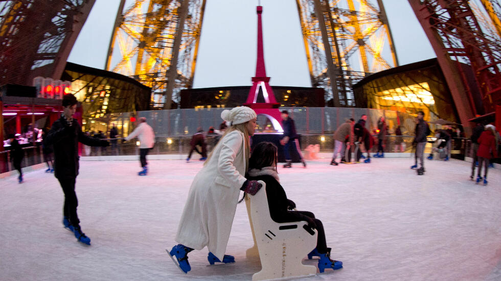 Christmas Ice Skating.Christmas In France From Festive Funfairs To Eiffel Tower