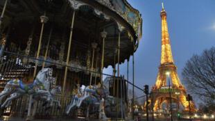 An empty merry-go-round near the Eiffel Tower.