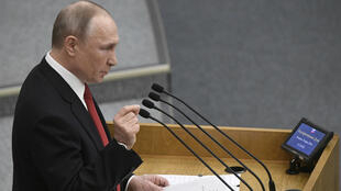 Russian President Vladimir Putin addresses lawmakers debating on the second reading of the constitutional reform bill during a session of the State Duma, Russia's lower house of parliament, in Moscow on March 10, 2020.
