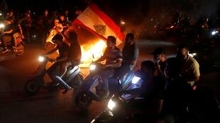 Demonstrators ride on motorbikes during a protest against fall in Lebanese pound currency and mounting economic hardship, in Beirut, Lebanon June 11, 2020.