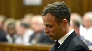 Oscar Pistorius lors d'une audience au tribunal de Pretoria, le 21 octobre 2014.