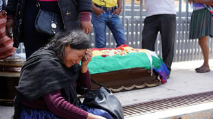 A woman reacts near the coffin of a supporter of former Bolivian President Evo Morales, who died during clashes on Friday, in Cochabamba, Bolivia, November 16, 2019.
