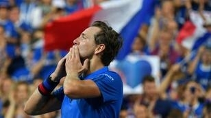 France's Lucas Pouille gestures to the crowd after clinching the hosts' second point in their Davis Cup semi-final against Spain