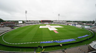 Covers are on as rain delays the start of play on the third day of the second Test between England and the West Indies at Old Trafford on Saturday