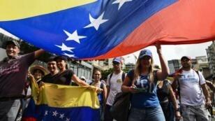 متظاهرون في فنزويلا، 23 يناير/كانون الثاني 2019