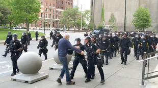Police push a protestor in Buffalo, New York, on June 5, 2020.