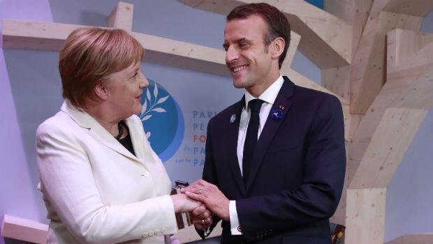 La canciller alemana, Angela Merkel, y el mandatario francés, Emmauel Macron, durante la apertura del Foro de París por la Paz, el 11 de noviembre de 2018.