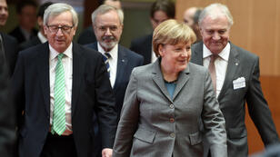 European Commission President Jean-Claude Juncker and German Chancellor Angela Merkel arrive at an EIB conference in Berlin, on March 2, 2015. (AFP)