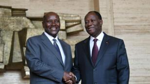 Daniel Kablan Duncan, Premier ministre ivoirien (à gauche) avec le président Alassane Ouattara lors de sa nomination début janvier.