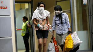 People cover their faces while leaving Hospital Cosme Argerich, after the first fatality from coronavirus in Latin America was confirmed, in Buenos Aires, Argentina March 7, 2020.