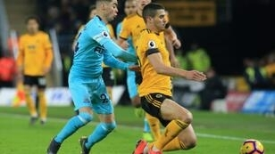 Newcastle's Miguel Almiron challenges Wolves' Conor Coady