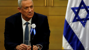 Benny Gantz, leader of the Blue and White party, looks on during a party faction meeting at the Knesset in Jerusalem October 3, 2019.