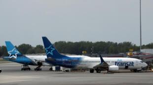 Des avions d'Air Transat à l'aéroport Pierre-Elliott-Trudeau de Montréal, au Canada, le 1er juin 2018