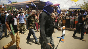 Decenas de manifestantes salieron a las calles de Masaya, Nicaragua, para protestar contra el mandato del presidente Daniel Ortega el 21 de junio de 2018.