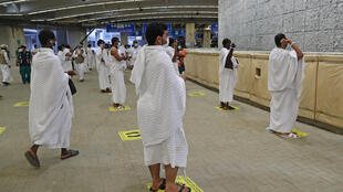 Pilgrims hurl pebbles at a wall symbolising the devil in the last major ritual of the hajj, this year sharply scaled back in the face of the novel coronavirus