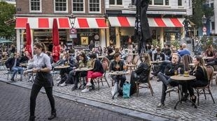Customers at a café in Amsterdam, Holland, on September 26, 2020.