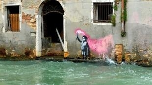 This image, presumed to be by Banksy, appeared on the outer wall of a house overlooking the canal Rio de Ca Foscari, in Venice