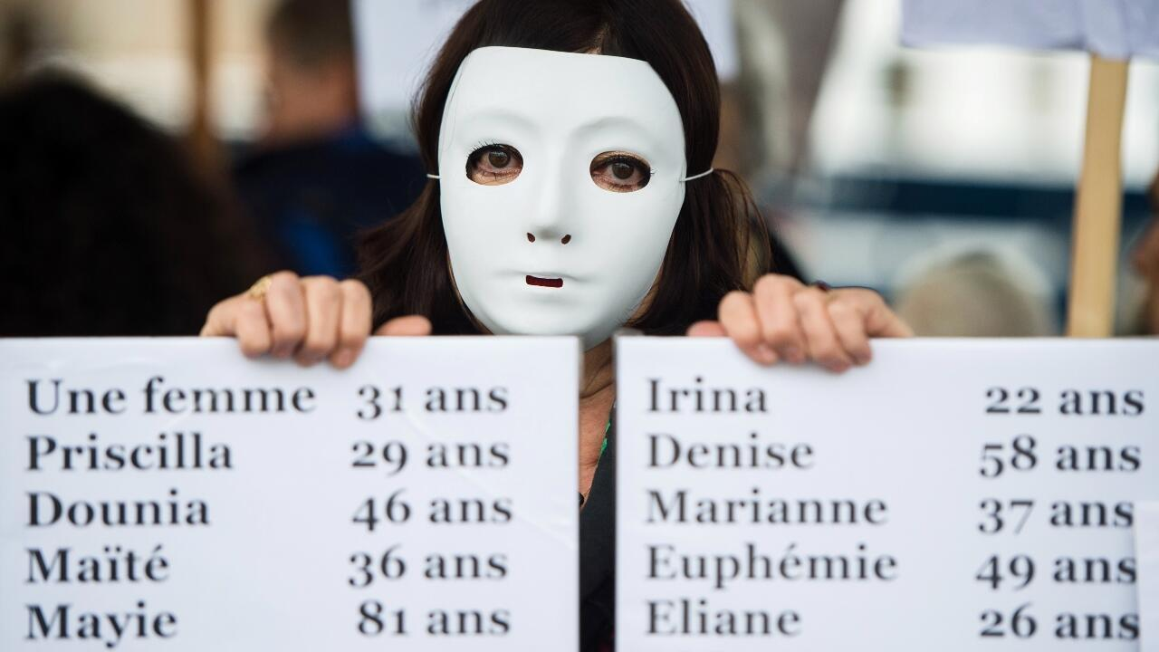 A woman holds a placard enumerating the names of feminicide victims in France in 2019, during a protest condeming violence against women in Marseille, France, on November 23, 2019.