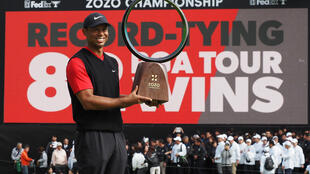 Tiger Woods of the US celebrates winning the first Zozo Championship in Japan last year. This year's event has been moved to California