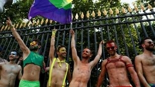 The marchers wound their way through the French capital under the rainbow colours of the LGBT community