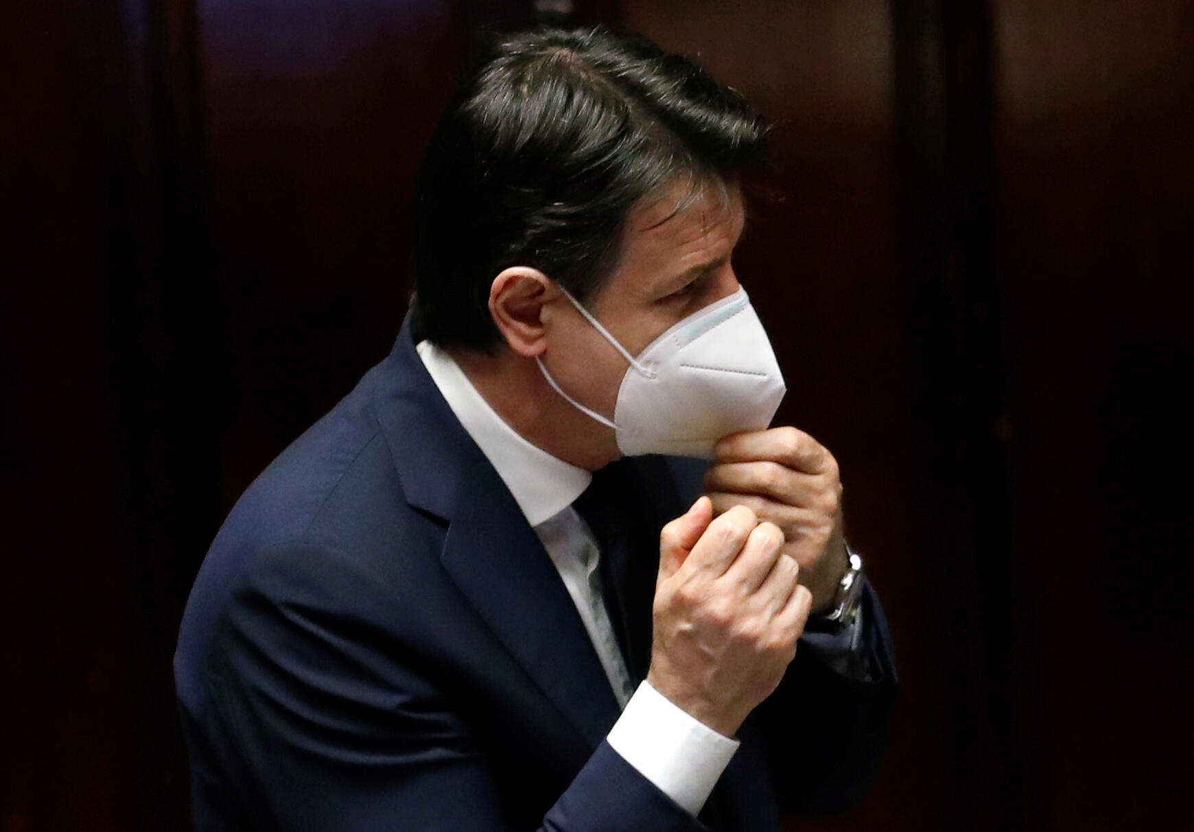 Prime Minister Giuseppe Conte wears a face mask as he attends a session of the lower house of parliament in Rome on April 21, 2020.