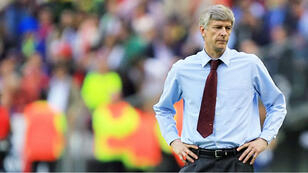 In this file photo taken on May 17, 2006 Arsenal's French coach Arsene Wenger is seen during the UEFA Champion's League final football match Barcelona vs. Arsenal, 17 May 2006 at the Stade de France in Saint-Denis, northern Paris. Arsene Wenger will bring his 22-year stay in charge of Arsenal to a close at the end of the season, the Frenchman announced on April 20, 2018.