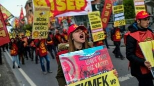 Protesters march in a demonstration against the Turkish government's economic policies in Istanbul