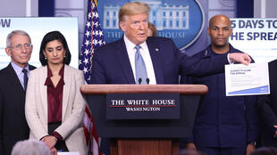 US President Donald Trump, surrounded by members of the Coronavirus Task Force, at a press conference on March 16, 2020 in Washington, D.C., USA.