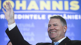 Incumbent candidate Klaus Iohannis reacts after receiving the first exit poll results following the second round of a presidential election in Bucharest, Romania, November 24, 2019.