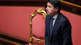 Italian Prime Minister Giuseppe Conte stands during a session in the Senate, the upper house of parliament, on the spread of COVID-19 in Rome, Italy on March 26, 2020.