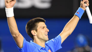 World number one Novak Djokovic celebrates after defeating Andy Murray in the final of the Australian Open on Sunday February 1, 2015