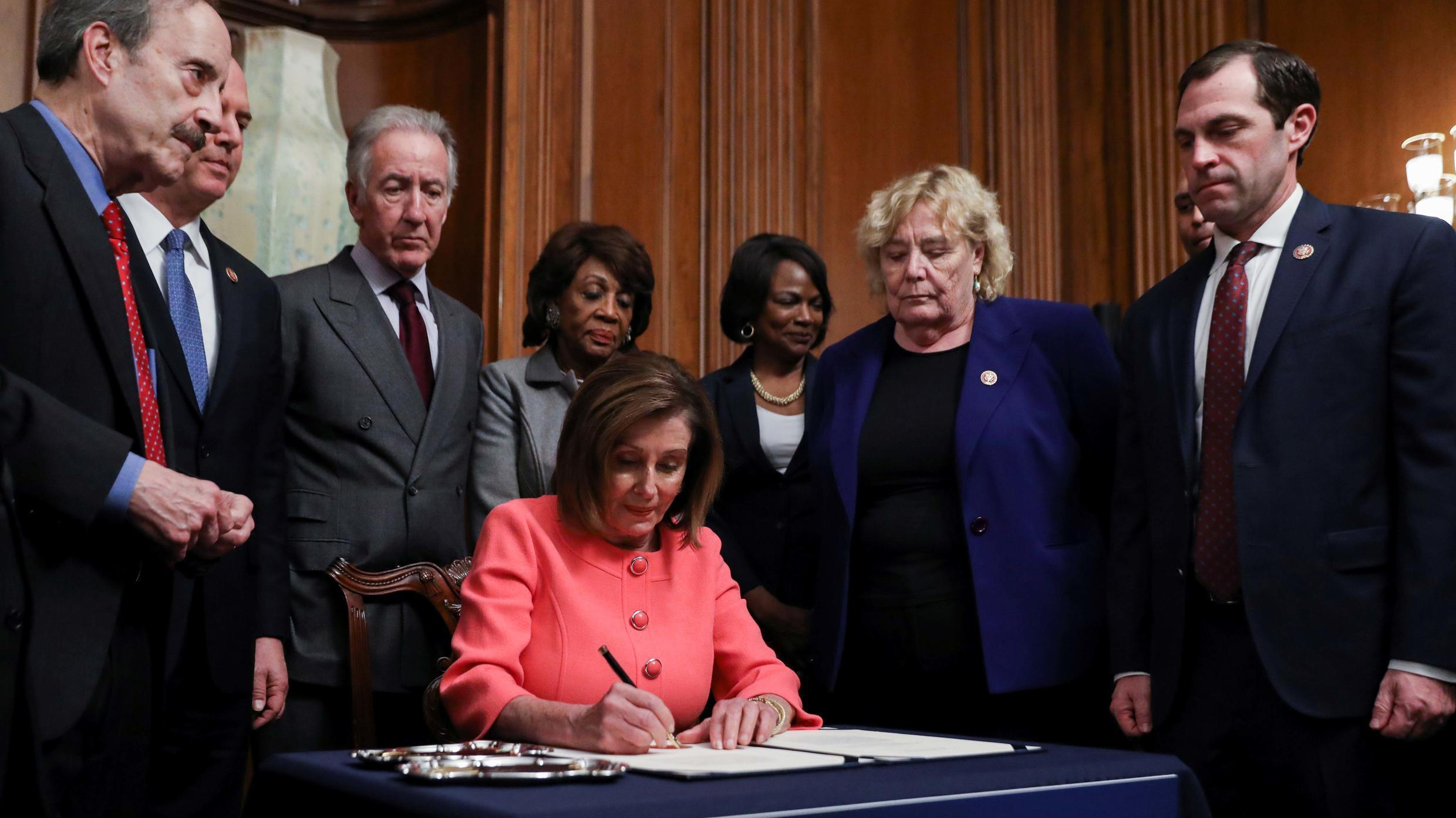 U.S. House Speaker Nancy Pelosi (D-CA) is surrounded by the House impeachment managers and committee chairs as she signs the two articles of impeachment of U.S. President Donald Trump before sending them over to the U.S. Senate during an engrossment ceremony at the U.S. Capitol in Washington, U.S., January 15, 2020.