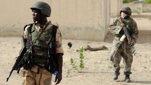 File photo of Nigerian soldiers patrolling in the north of Borno state close to a former Boko Haram camp.