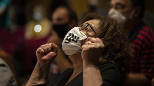 Magda Fyssa, the mother of late Greek rap singer Pavlos Fyssas, who was stabbed and killed by a supporter of the extreme right Golden Dawn party in 2013 triggering a crackdown on the party, reacts immediately after the delivery of the verdict of a court decision in Athens, Wednesday, Oct. 7, 2020.