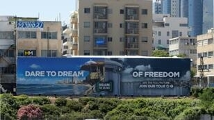 """The billboard put up alongside Tel Aviv's busiest main road by an Israeli anti-occupation group is a play on the 2019 Eurovision slogan """"Dare to Dream"""""""
